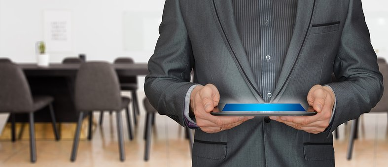 A man holding a tablet - Way To Generate Leads